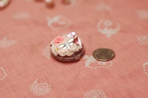 This is a Bon Bon lip gloss container with some decorations on it. I like it cause it's so tiny.