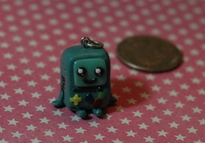 This little guy is from the show Adventure Time. I have never seen the show personally, but my boyfriend is a big fan and likes this character so I made a charm for him. It came out realllllly good, I am having a hard time letting him take the charm hehehe
