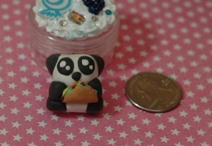 This is a panda bear holding a taco. I made it for a friend so I hope he likes it as much as I do!
