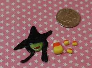 The witch is from Wicked, this was a practice version I made prior to completing the movie poster charm.  The candy corn and the wicked witch will most likely go on a Halloween themed box of some sorts.