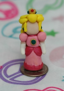 Princess Toadstool from Super Mario Brothers. I still haven't figured out what kind of expression I want her to have, so she is faceless for now V_V