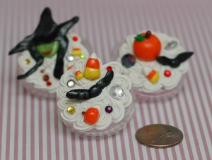 Here are the three Halloween containers I decoden'd. The golden snitch lookin' bats, pumpkins, candy corn, and wicked witch head were made by me. (You may recognize the witch and small candy corns from a prior post. Yay they finally got a home:) )