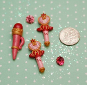 On the left is Sailor Moon's Disguise Pen. Very easy to make. :D  The two wands are Sailor ChibiMoon's Pink Moon stick.