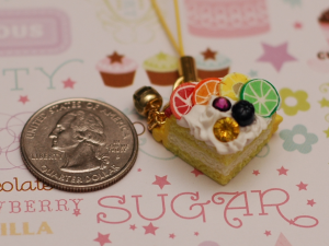 This is a cake charm with cane slices, in a quasi rainbow pattern.