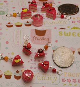 You're gonna have to click the picture to see up close on these. They are really tiny cake slice charms. I haven't figured out what to put them on yet soooo anyone have an idea? :p