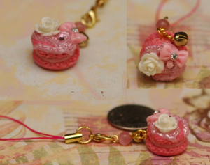 Here we have tiny pink macaron with some embellishments on the top. It's so cute, that I even put one on my cell phone (with the rest of the charm family :P)