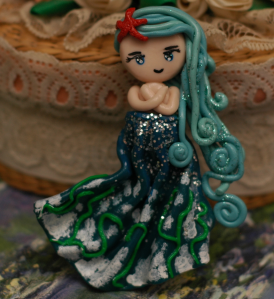 Water, in all it's elegance. The white and green on the dress are sea foam and sea weed. This one was fun to make, but I wish I had spent more time on her hair.