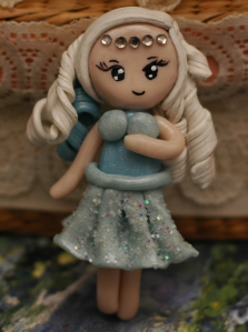 Wind Chibi. This is the first one from the series that I made, and I don't think it came out too well compared to Debby's. It did teach me a lot though, and that's what counts!