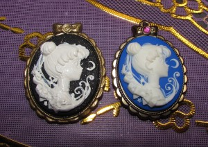 The pendant on the right is the original from Japan from which I made a mold and then the pendant on the left from polymer clay/ I painted the white and gold onto the clay. Not too shabby for a first try! I've been wearing a pink background version of this for days now. I love it sooo much <3