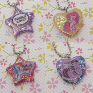 Just a few MLP necklaces. It is really difficult to fit stickers in these molds, but I can't find any others around this size that give a shine finish, most ice cube trays and candy molds in cute shapes leave the resin with a matte finish.